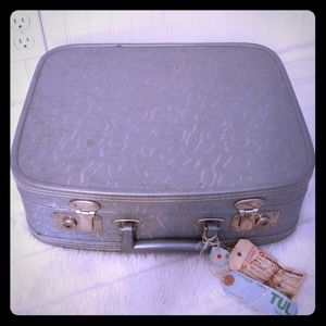 textured vinyl suitcase great for decor & stacking